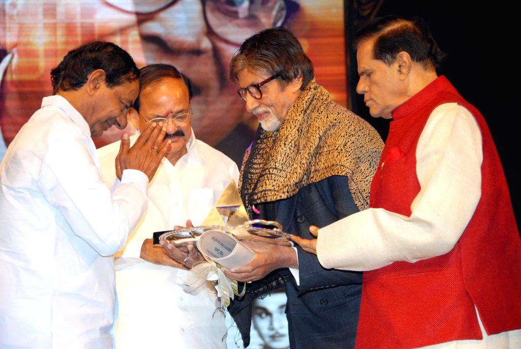 Telangana Chief Minister K. Chandrashekar Rao and Union Minister Venkaiah Naidu presenting Akkineni Nageswara Rao Award - 2014 to superstar Amitabh Bachchan at Annapurna studios in Hyderabad on Dec. . - K. Chandrashekar Rao, Venkaiah Naidu and Amitabh Bachchan