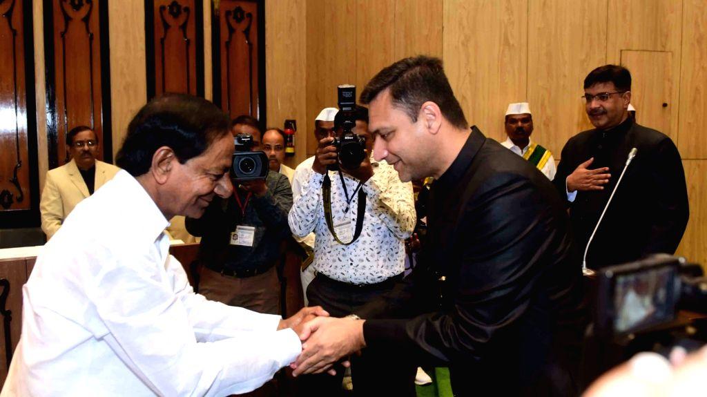 Telangana Chief Minister K. Chandrashekhar Rao being greeted by AIMIM MLA Akbaruddin Owaisi during the Budget Session of the state assembly in Hyderabad on Sep 9, 2019. - K. Chandrashekha