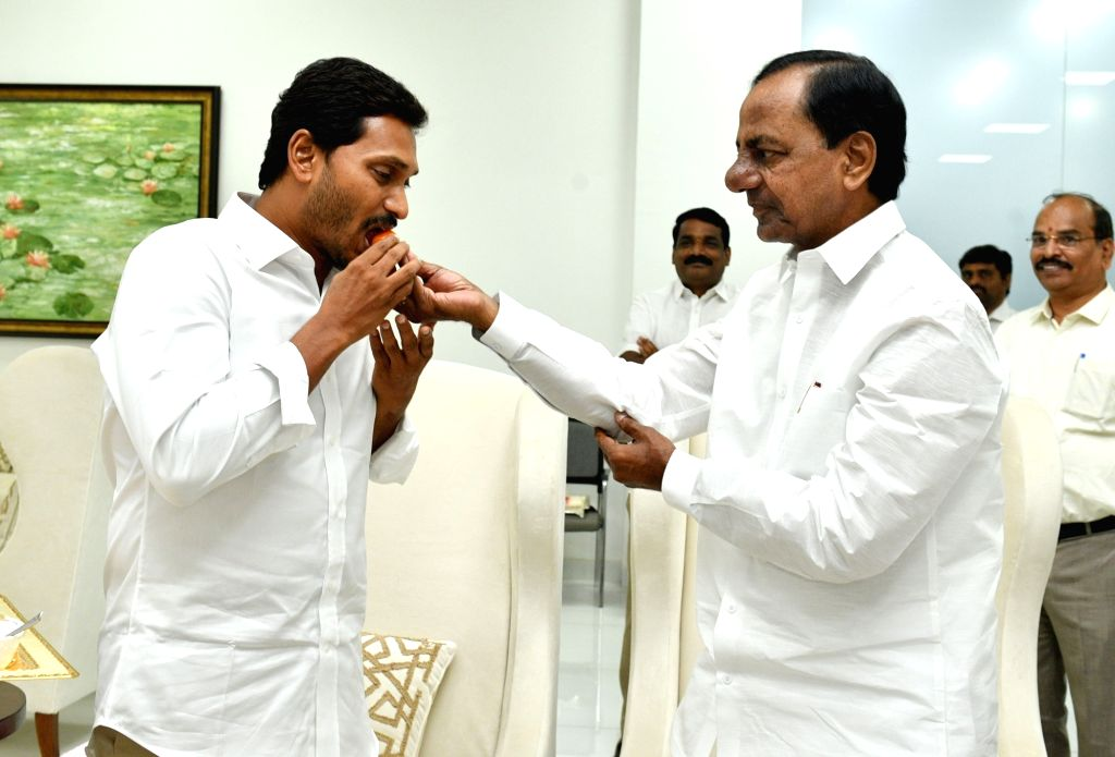Telangana Chief Minister K. Chandrashekhar Rao (KCR) and YSR Congress Party president Y. S. Jagan Mohan Reddy, who is set to take oath as the chief minister of Andhra Pradesh next week, ... - K. Chandrashekha