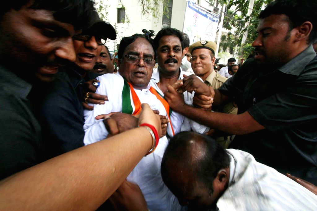 Telangana Congress chief Ponnala Lakshmaiah being taken away by police for demonstrating against shortage of electricity to farmers in Hyderabad on Sept 12, 2014.