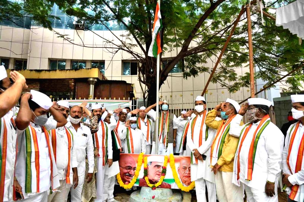Telangana Congress President N. Uttam Kuamr Reddy along with other leaders of the party hoist the national flag during Hyderabad Liberation Day celebrations at the state party headquarters ...