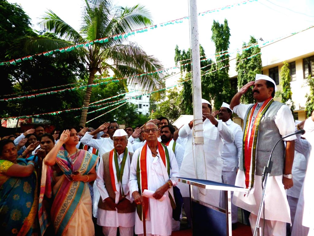 Telangana Congress president N Uttam Kumar Reddy hoists the national flag at party office on Independence Day in Hyderabad on Aug 15, 2016.