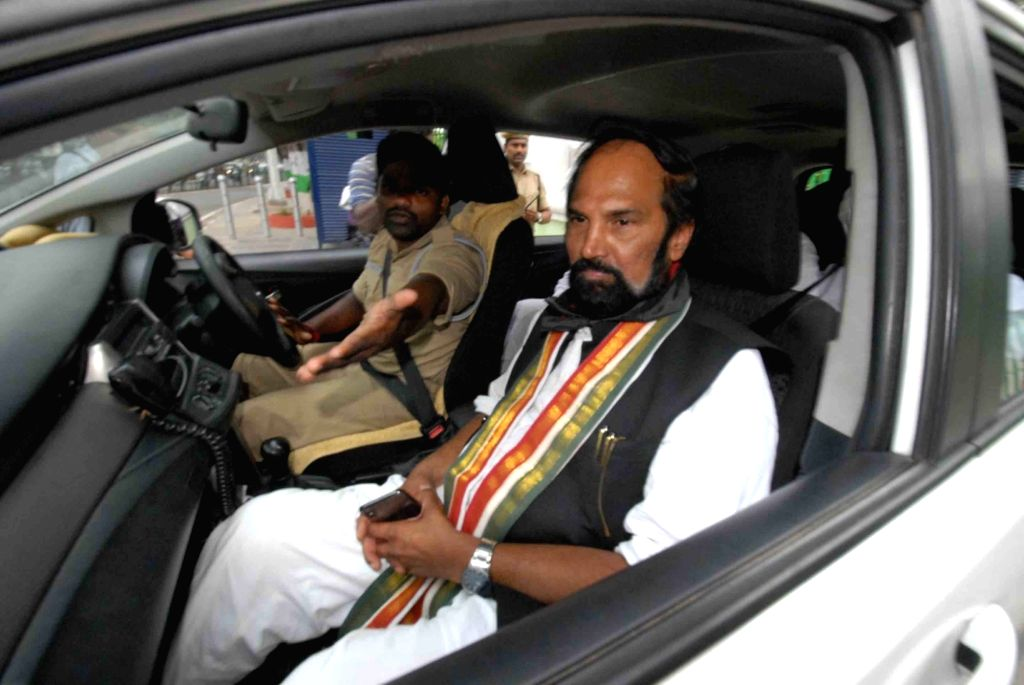 Telangana Congress President N. Uttam Kumar Reddy being taken away after he along with other party leaders, was arrested for protesting at the Telangana Assembly against the 12 party MLAs ...
