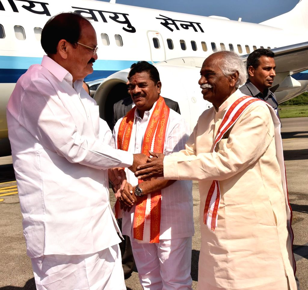 Telangana Deputy Chief Minister Mahmood Ali and BJP leader Bandaru Dattatreya recieve Vice President M. Venkaiah Naidu on his arrival at Begumpet Airport in Hyderabad on Sept 16, 2017. - Mahmood Ali and M. Venkaiah Naidu