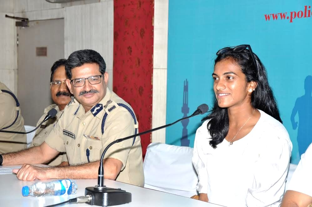 Telangana Director General of Police Anurag Sharma and badminton player PV Sindhu during a press conference in Hyderabad on Oct 13, 2016. - Anurag Sharma