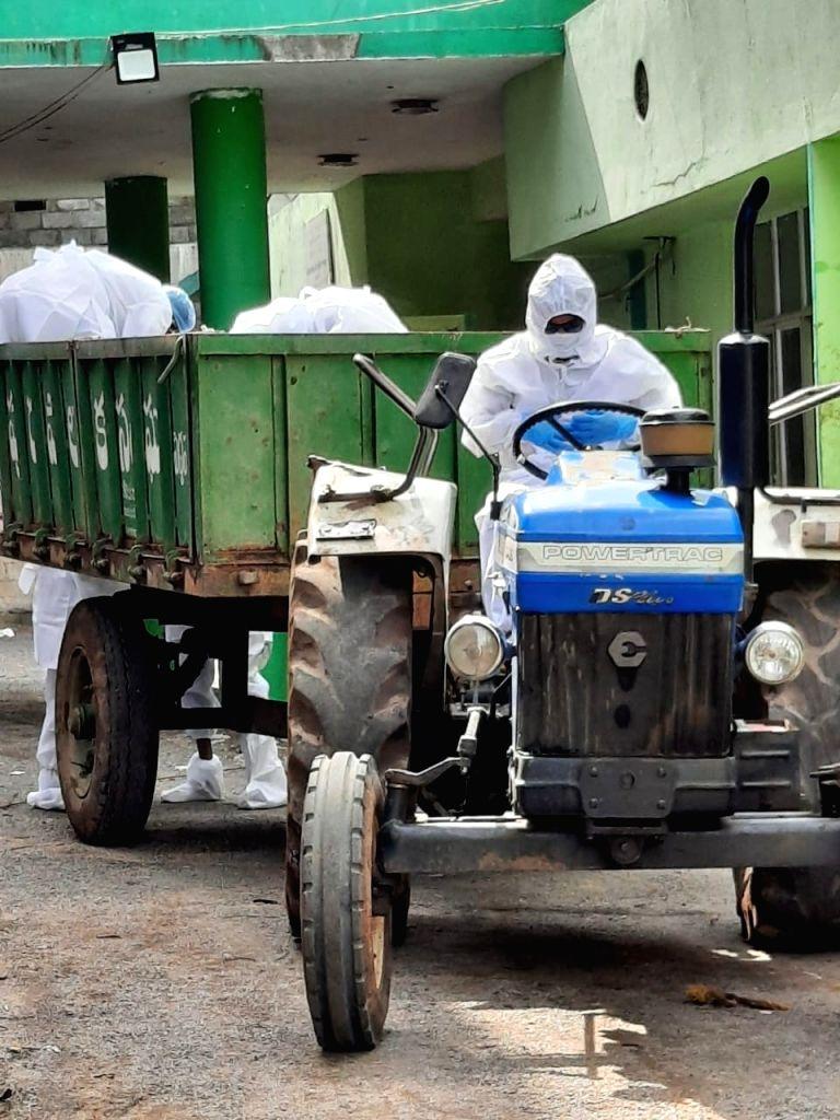Telangana doctor turns driver to shift COVID victim's body. (Photo:  Mohammed Shafeeq IANS)
