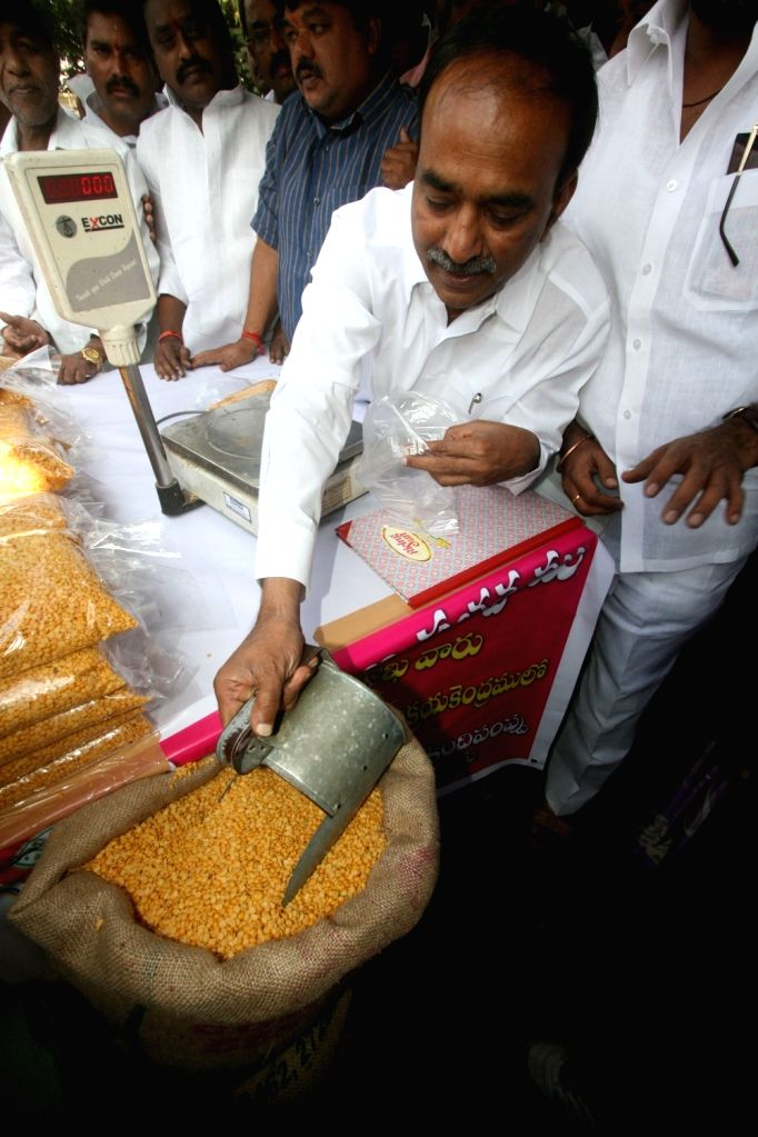 Telangana Finance Minister E Rajender distribute subside Toor Dal at a Government stall in Hyderabad, on Oct 31, 2015.
