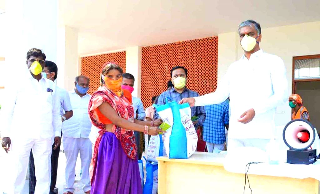 Telangana Finance Minister T. Harish Rao distrubutes food and cash among migrant workers on Day 7 of the 21-day nationwide lockdown imposed as a measure to contain the spread of  ... - T. Harish Rao