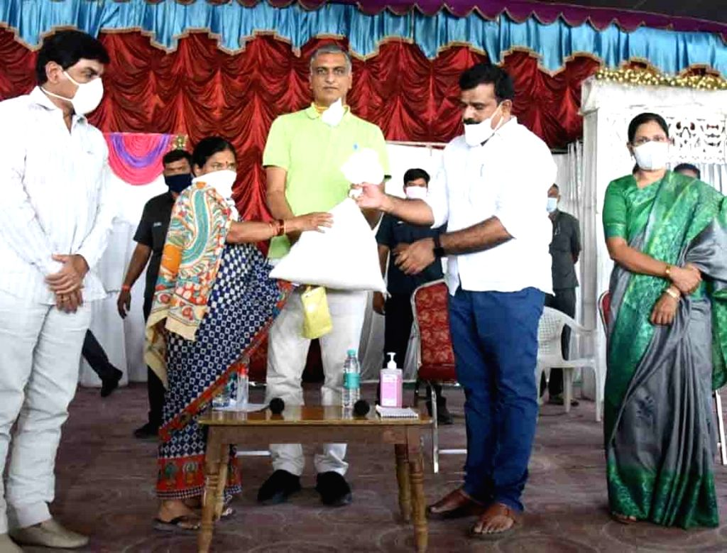 Telangana Finance Minister T. Harish Rao distributes essential commodities among people at Jogipet during the extended nationwide lockdown imposed to mitigate the spread of coronavirus; on ... - T. Harish Rao