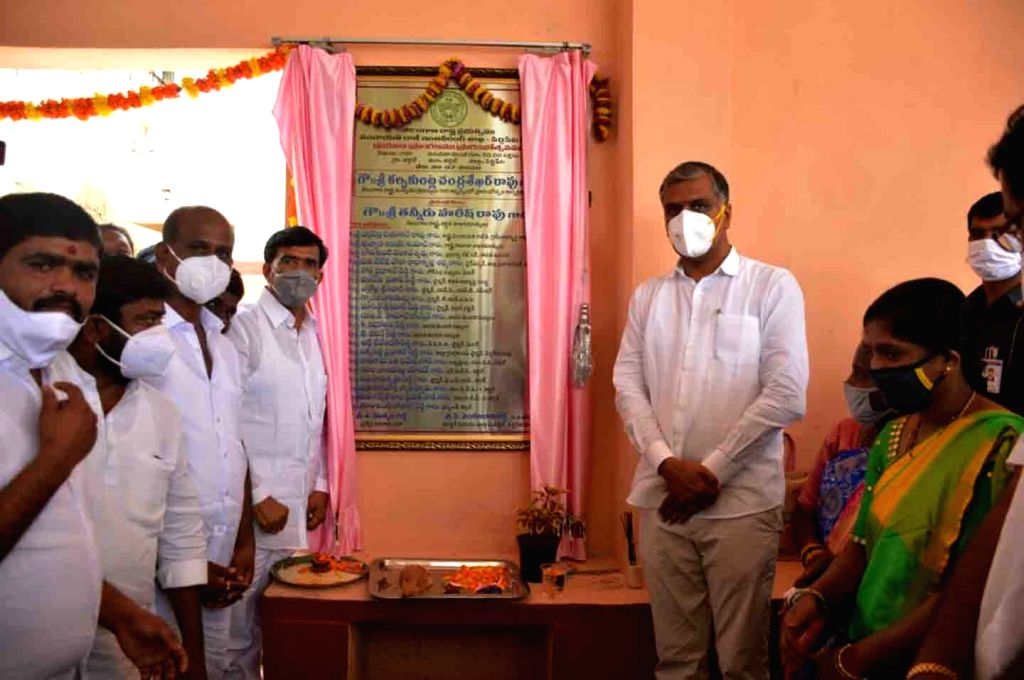 Telangana Finance Minister T. Harish Rao unveils the plaque to inaugurate a newly constructed Road Transport Corporation bus stand in Gajwel, Siddipet on July 30, 2020. - T. Harish Rao