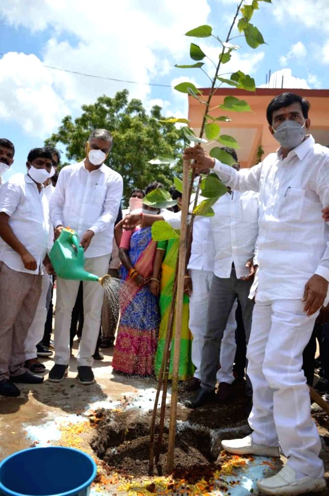 Telangana Finance Minister T. Harish Rao waters a plant at the inauguration of a newly constructed Road Transport Corporation bus stand in Gajwel, Siddipet on July 30, 2020. - T. Harish Rao