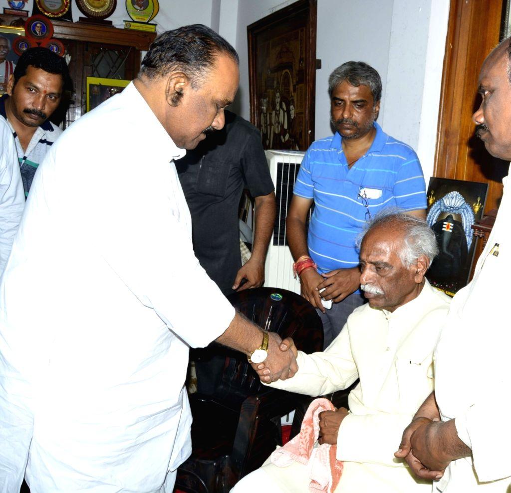 Telangana Home Minister Naini Narshimha Reddy consoles Union Minister and BJP leader Bandaru Dattatreya after his son Bandaru Vaishnav, 21, died of a massive heart attack in Hyderabad on ... - Naini Narshimha Reddy