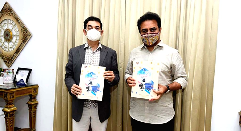 Telangana IT and Industries Minister KT Rama Rao releases the annual report of Industries and Commerce Department at his camp office in Hyderabad on June 23, 2020. - K and Rao