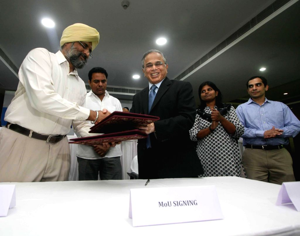 Telangana IT minister K T Rama witnesses as Dr. Sandhya Chintala of NASSCOM signs a memorandum of understanding (MOU) with Faizan Mustafa, the Vice Chancellor of Nalsar Law University in Hyderabad on - K T Rama