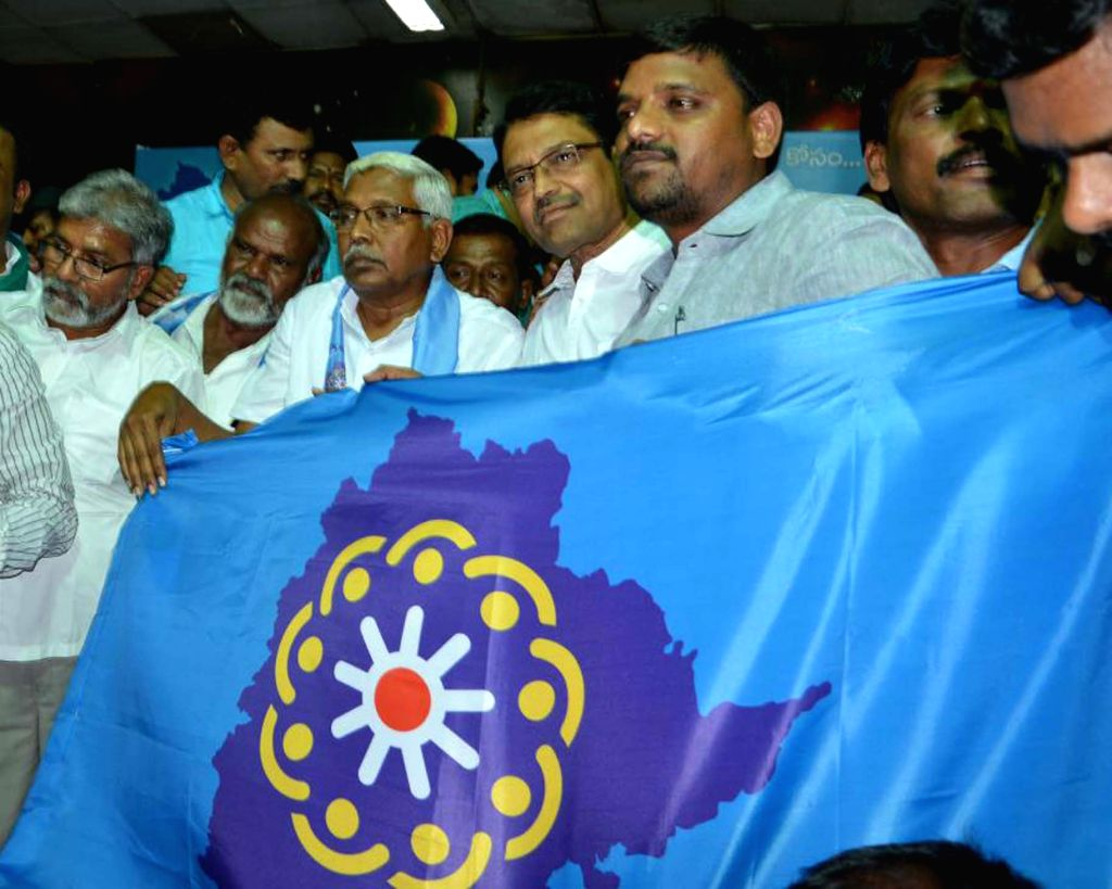 Telangana Joint Action Committee Chairman M. Kodandaram unveils the flag of his newly launched party Telangana Jana Samiti, in Hyderabad on April 4, 2018.