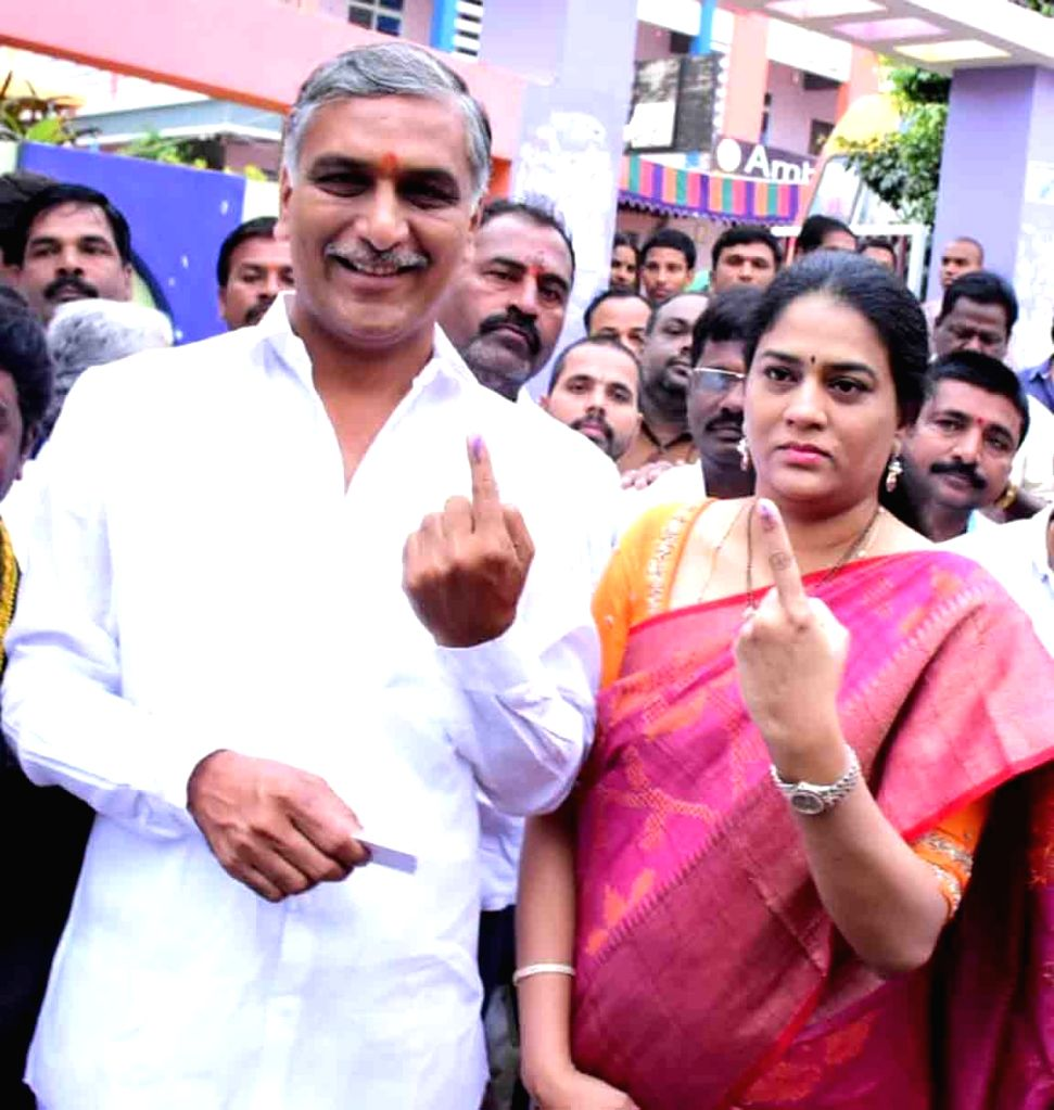 Telangana Minister and TRS leader T Harish Rao and his wife Srinitha Rao show their inked fingers after casting their votes for Telangana Assembly elections, in Hyderabad on Dec 7, 2018. - T Harish Rao and Srinitha Rao