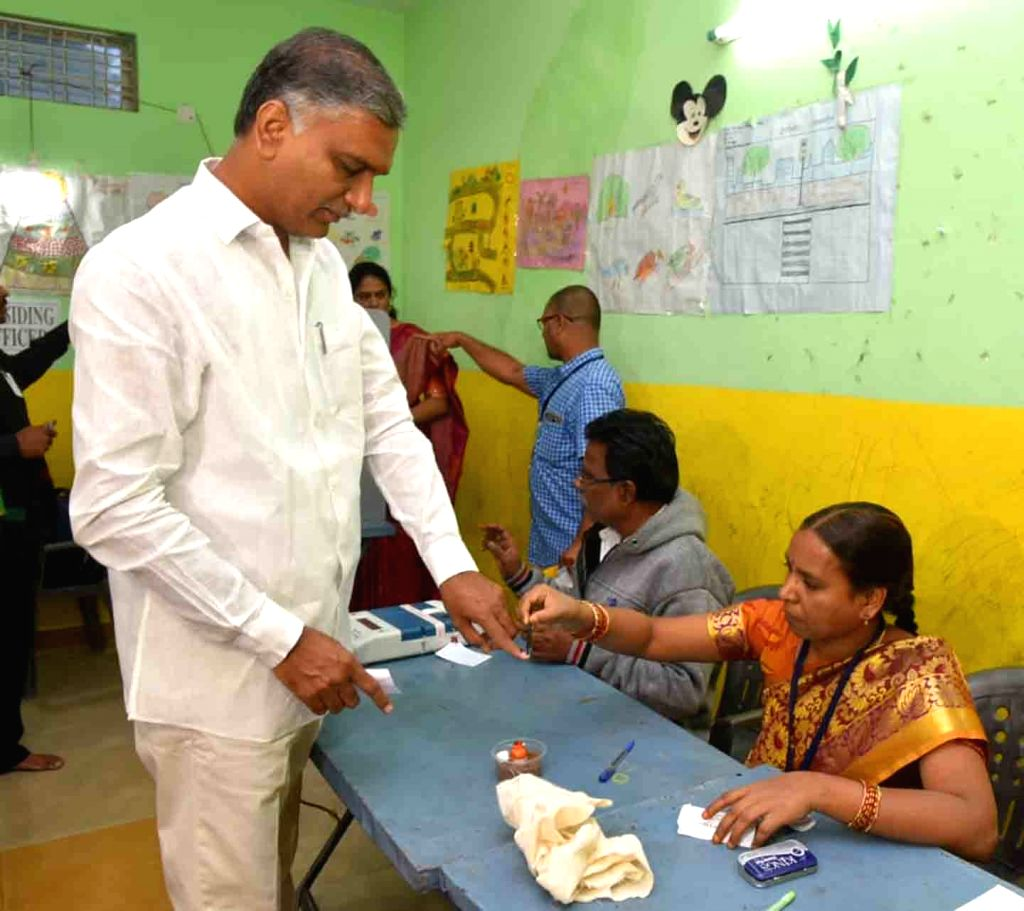 Telangana Minister and TRS leader T Harish Rao gets his finger inked after casting his vote for Telangana Assembly elections at a polling station in Hyderabad, on Dec 7, 2018. - T Harish Rao