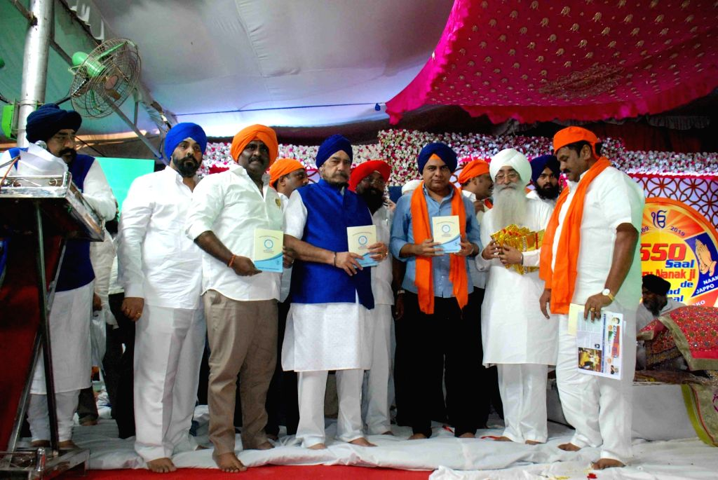 Telangana Minister K. T. Rama Rao during the 550th birth anniversary celebrations of Guru Nanak Dev in Hyderabad on Nov 12, 2019. - K. T. Rama Rao and Nanak Dev