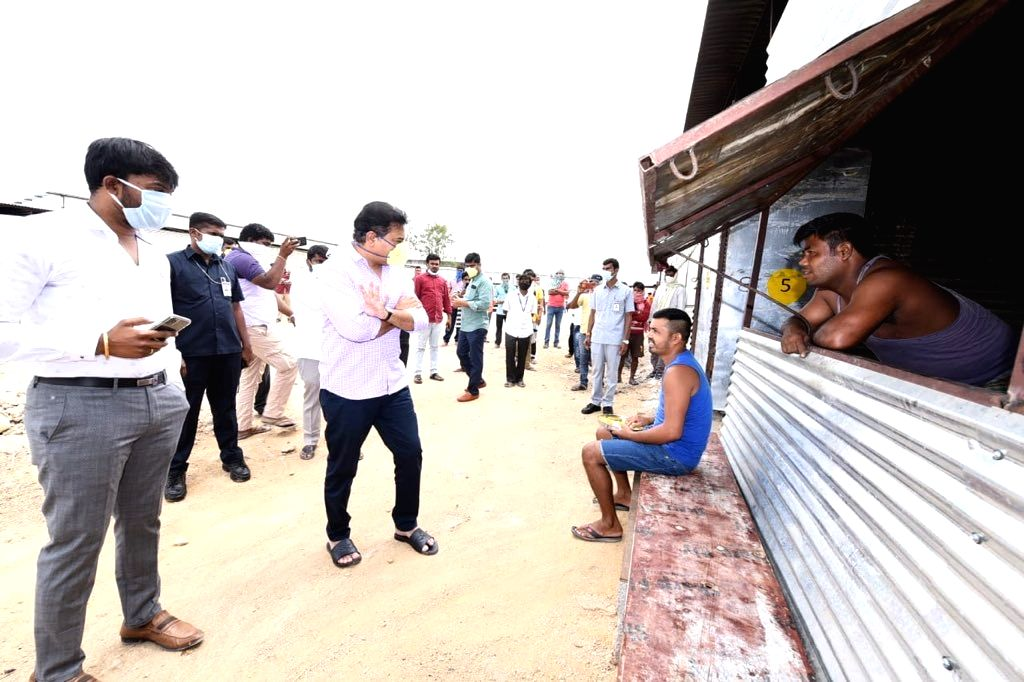 Telangana Minister K. T. Rama Rao visits temporary shelters provided for migrant workers at a construction site at Gachibowli in Hyderabad. - K. T. Rama Rao