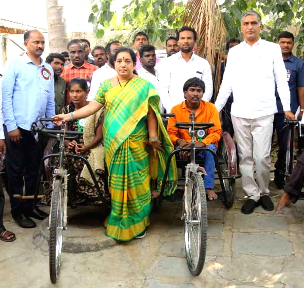 Telangana Minister T. Harish Rao distributes tricycles to differently able persons on the occasion of World Disability Day, in Hyderabad on Dec 3, 2019. - T. Harish Rao