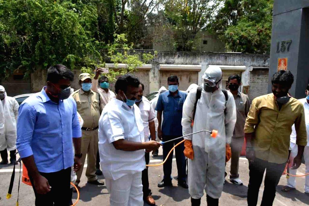 Telangana Minister Talasani Srinivas Yadav sprays disinfectants at his office premises at Nampally in Hyderabad during the extended nationwide lockdown imposed to mitigate the spread of coronavirus pandemic, on Apr 16, 2020. (Photo: IANS) - Talasani Srinivas Yadav
