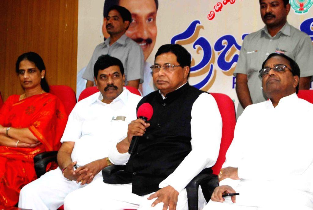 Telangana ministers led by K Jana Reddy, Minister for Panchayathraj addressing media on Jan 28. - K Jana Reddy