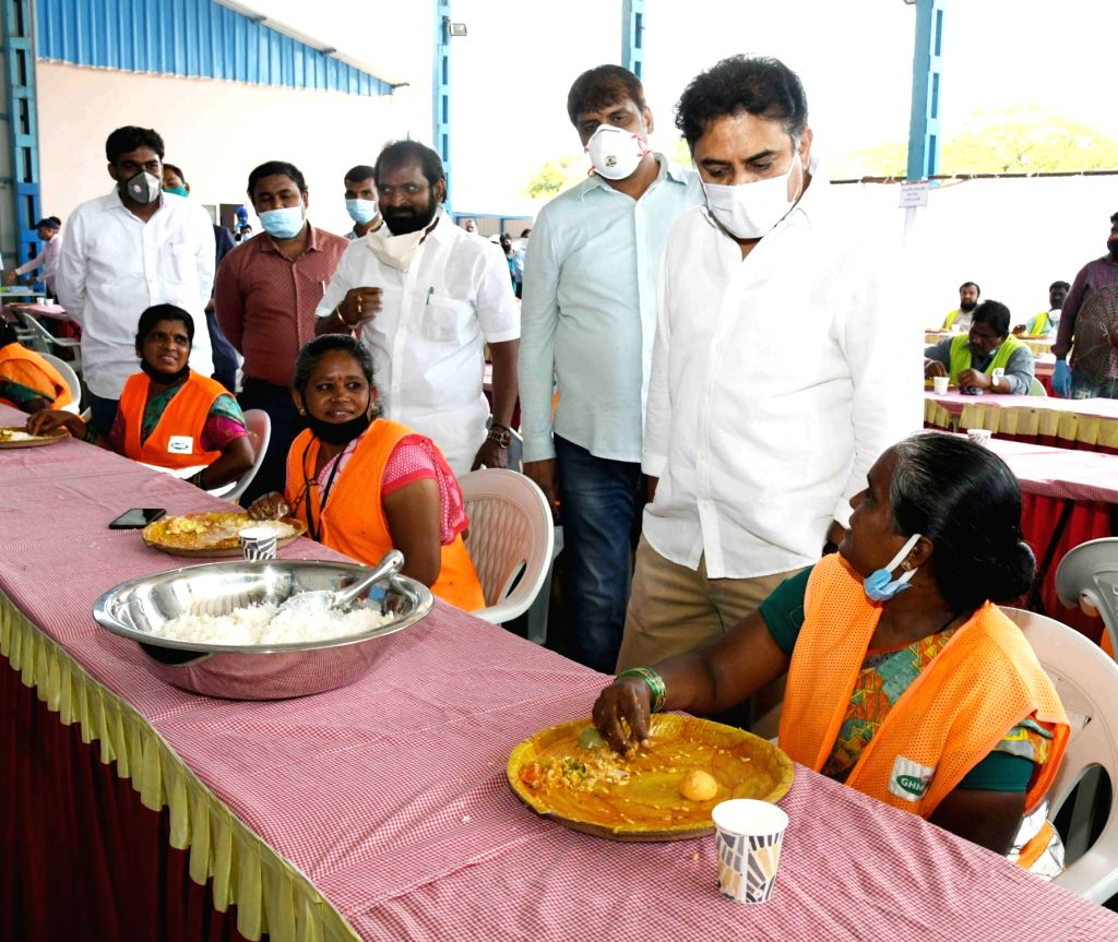 Telangana Municipal Administration and Urban Development Minister KT Rama Rao interacts with a sanitation worker in Hyderabad during the extended nationwide lockdown imposed to mitigate ... - K and Rao