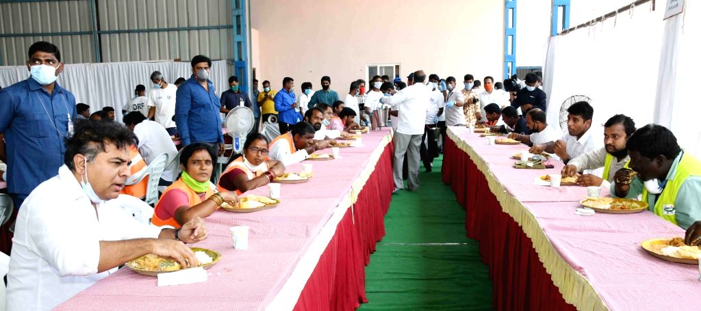 Telangana Municipal Administration and Urban Development Minister KT Rama Rao having lunch with sanitation workers in Hyderabad during the extended nationwide lockdown imposed to mitigate ... - K and Rao