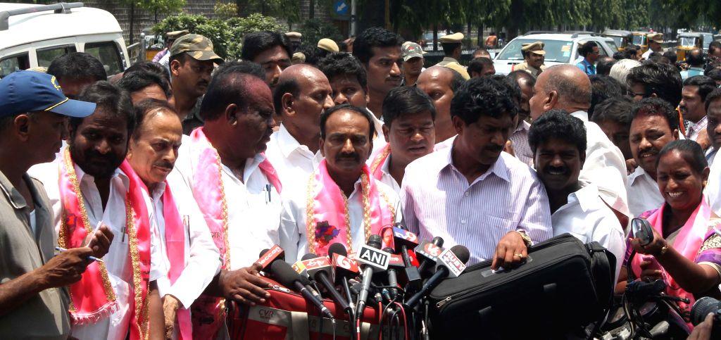 Telangana Rashtra Samithi (TRS) leader E Rajender addresses press after a party delegation led by TRS chief K Chandersheker Rao met Andhra Pradesh Governor E S L Narasimhan in Hyderabad on May 18, ... - K Chandersheker Rao