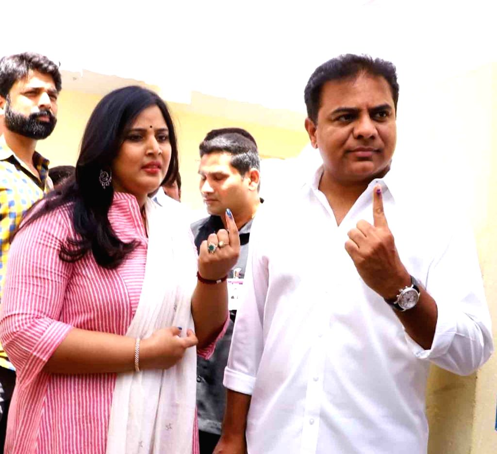 Telangana Rashtra Samithi (TRS) working president KT Rama Rao with his wife Shailima Kalvakuntla show their fore fingers marked with indelible ink after casting vote during the first phase ... - Rao