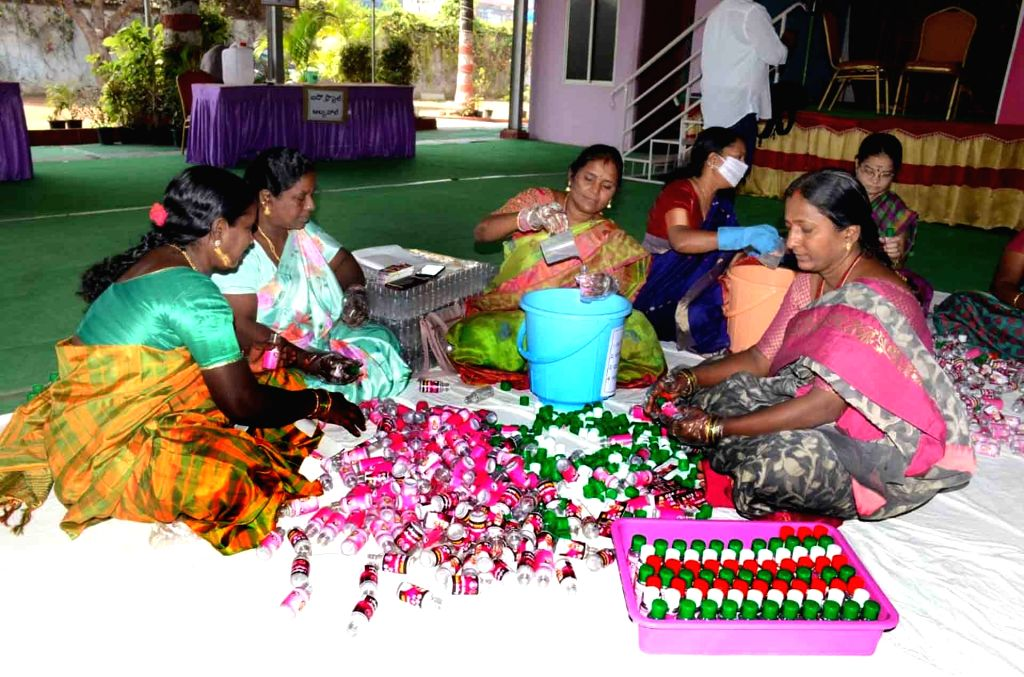 Telangana women activists busy making sanitiser amid supply shortage and high demand during COVID-19 pandemic, in Hyderabad on March 20, 2020.