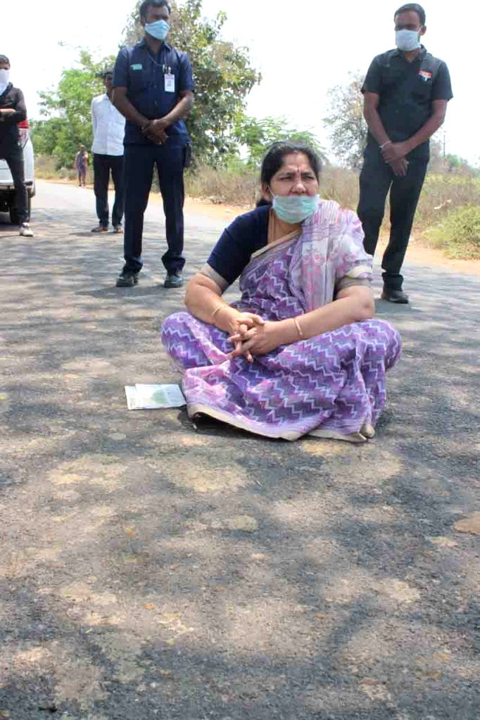 Telangana Women and Child Welfare Minister Satyavathi Rathod sits on a street as she interacts with a group of migrant laborers heading back to Maharashtra from Telangana's Mahabubabad, ... - Satyavathi Rathod