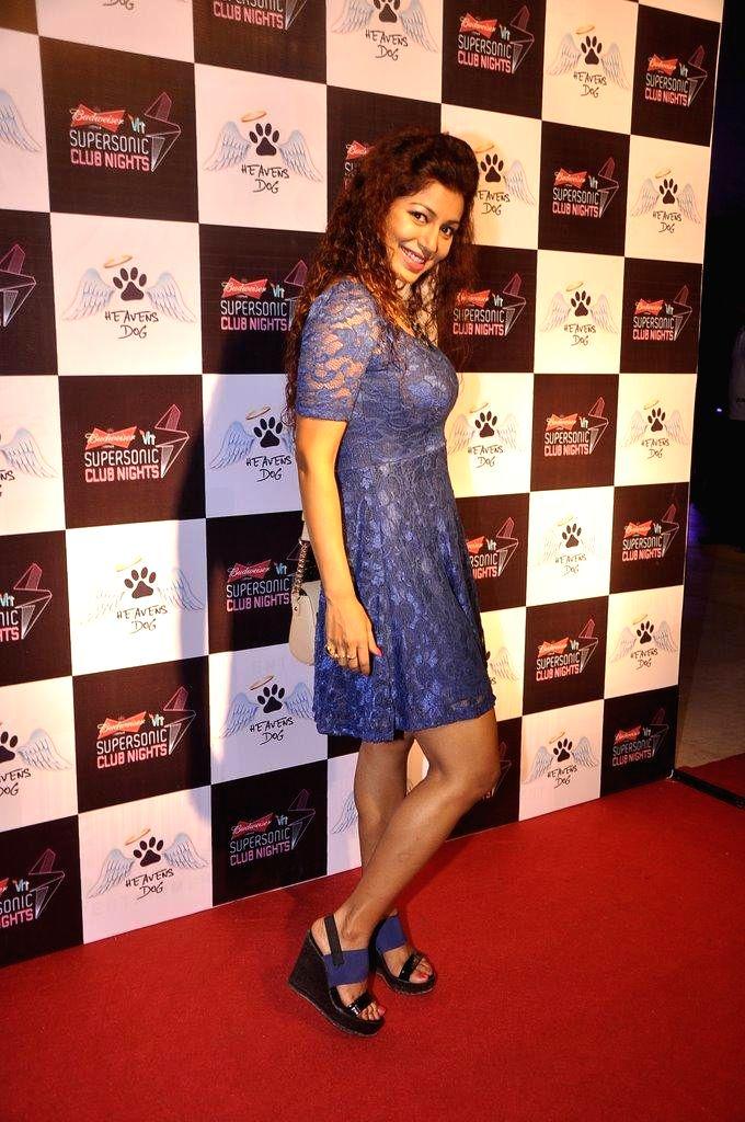 Television actor Debina Bonnerjee during the launch of restaurant Heavens Dog, in Mumbai, on Sept. 5, 2014. - Debina Bonnerjee