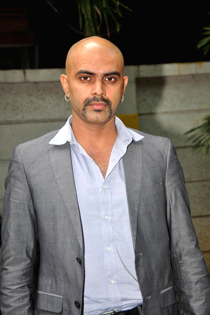 Television actor Raghu Ram during the music launch of film 3AM, in Mumbai, on Sept 9, 2014. - Raghu Ram