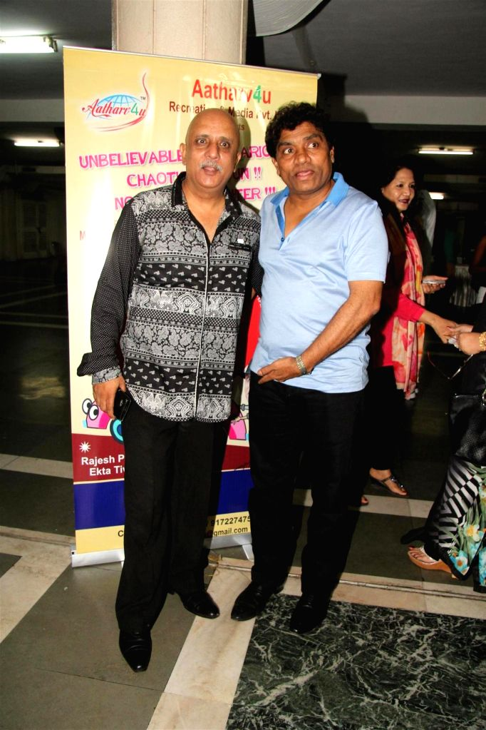 Television actor Rajesh Puri and Bollywood actor Johnny Lever during the party to celebrate the success of Hindi play `Sab Golmaal Hai`, in Mumbai, on July 5, 2015. - Rajesh Puri