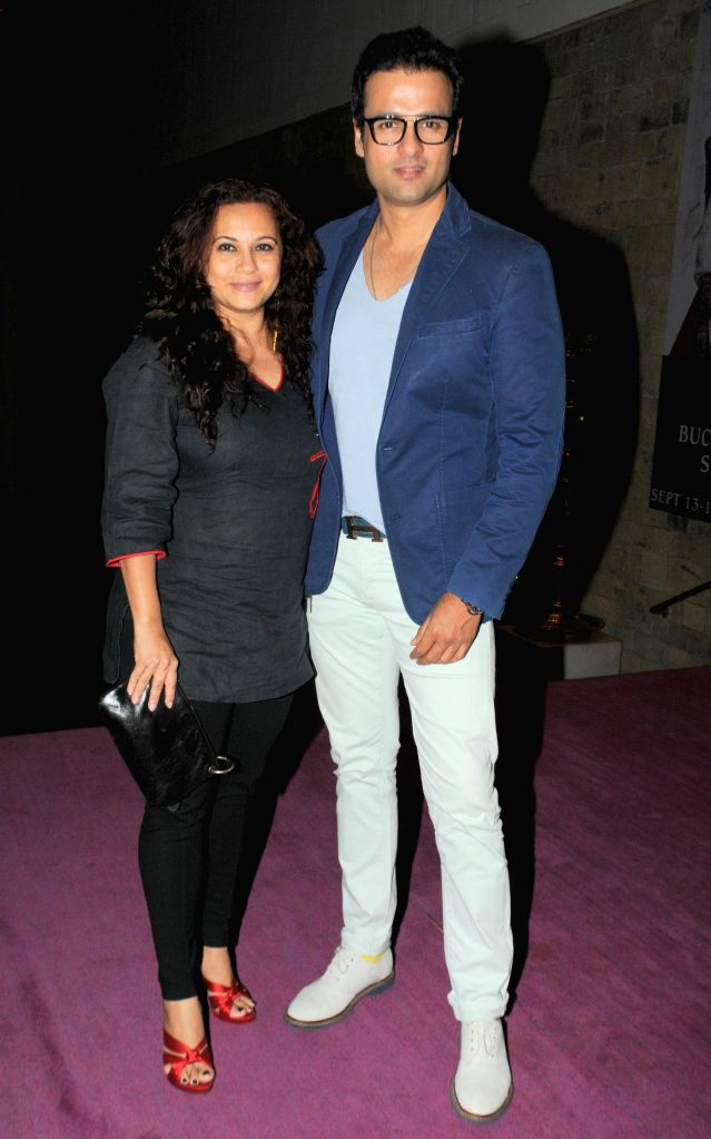 Television actor Rohit Roy with Wife during the fittings for the musical play Three Women in Mumbai on Sept. 5, 2014. - Rohit Roy