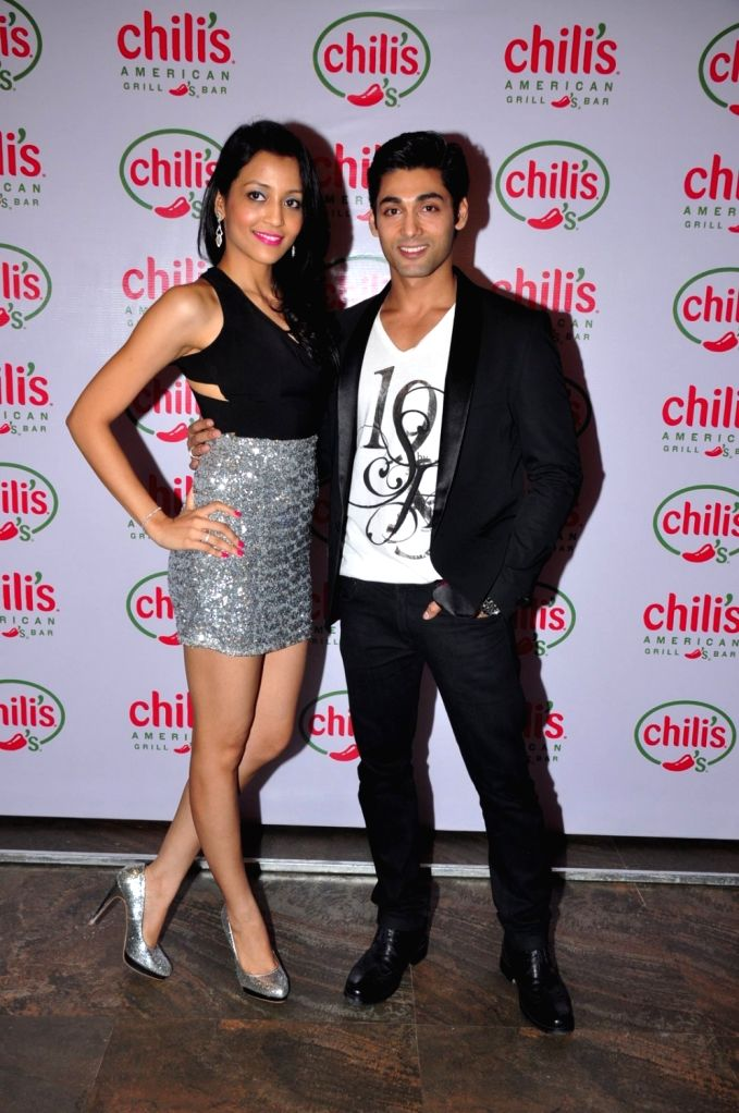 Television actor Ruslaan Mumtaz with his wife Nirali Mehta during his 1st wedding anniversary party at the Chili's American Grill and Bar, in Mumbai on Nov 15, 2015. - Nirali Mehta
