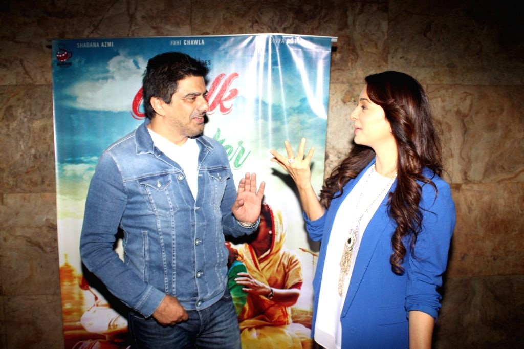 Television actor Samir Soni and actress Juhi Chawla during the screening of film Chalk n Duster in Mumbai on Jan 20, 2016. - Samir Soni and Juhi Chawla