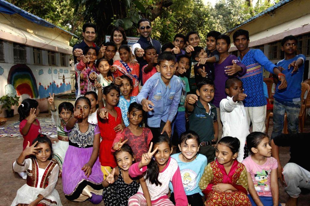 Television actors Karan Mehra, Nisha Rawal and Terence Lewis with children of Vatsalya Foundation during during during the launch of Nisha Rawal's song, Choti si Asha, to raise funds for ... - Karan Mehra and Terence Lewis