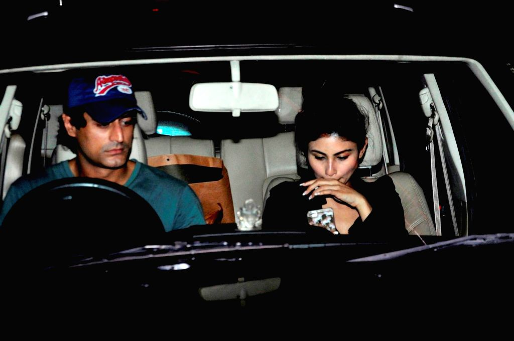 Television actors Mohit Raina and Mouni Roy at the Chhatrapati Shivaji International Airport, in Mumbai, on June 27, 2016. Actor arrived after attending the International Indian Film Academy ... - Mohit Raina and Mouni Roy
