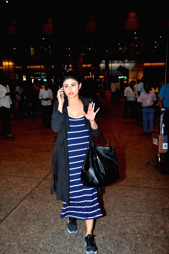 Television actress Mouni Roy at the Chhatrapati Shivaji International Airport, in Mumbai, on June 27, 2016. Actor arrived after attending the International Indian Film Academy (IIFA) Awards, ... - Mouni Roy