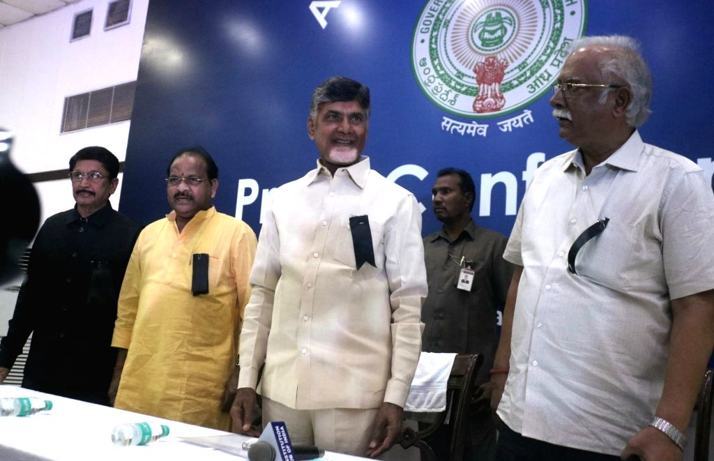 Telugu Desam Party leaders N. Chandrababu Naidu and Ashok Gajapathi Raju wear a black Badge in protest against the Central Government over the demand to grant special economic status to ... - N. Chandrababu Naidu