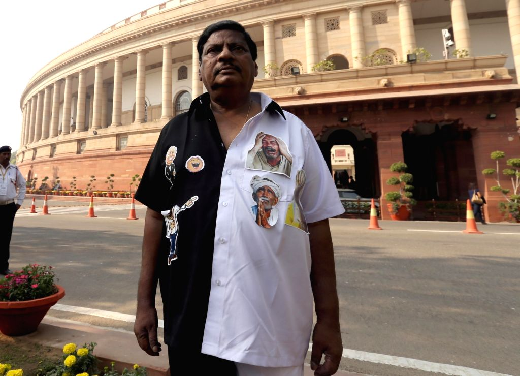 Telugu Desam Party MP N Sivaprasad protests dressed in a black-and-white attire to protest against demonetisation at the Parliament in New Delhi on Nov 29, 2016.