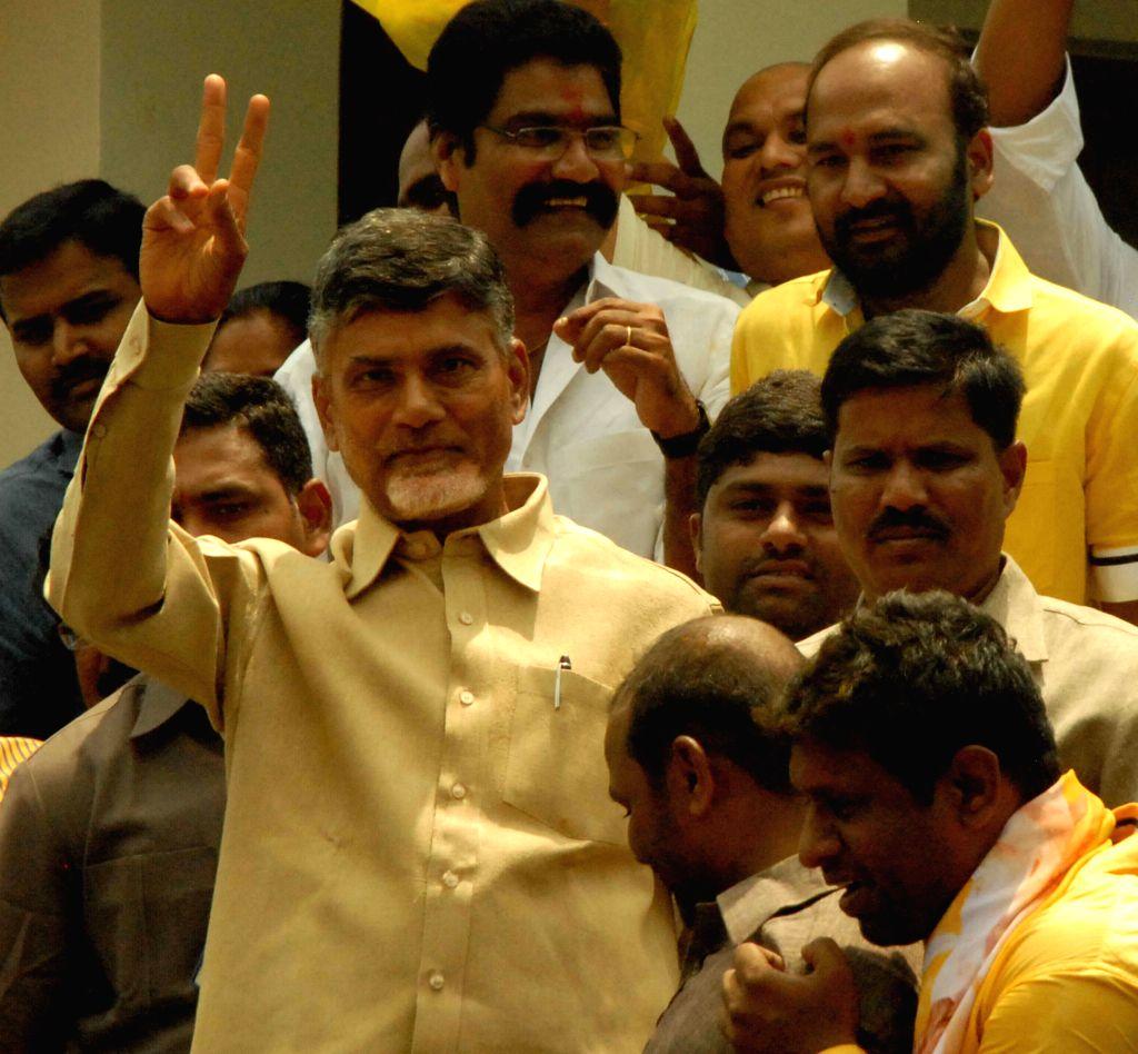 Telugu Desam Party (TDP) president N. Chandrababu Naidu celebrates his party's performance during 2014 Lok Sabha Elections in Hyderabad on May 16, 2014.