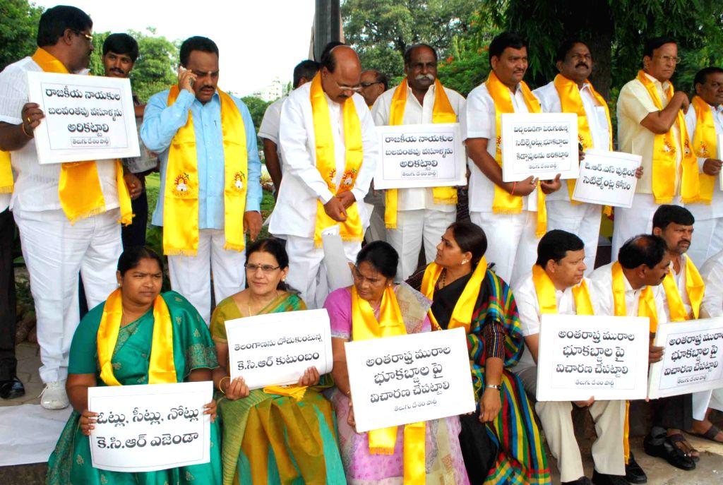 Telugu Desham Party legislatures protesting against