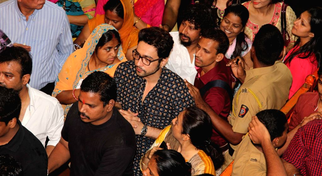 Telugu film `Lackhnawi Ishq` actor Adhyayan Suman and director Aanand Raut visited Lalbaughcha Raja for blessings in Mumbai on Sept. 5, 2014.