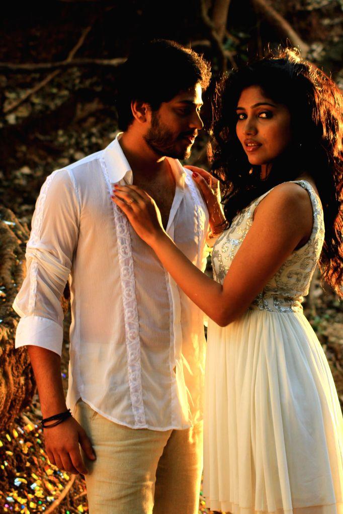 Telugu movie `Un Samayal Arayil` stills.