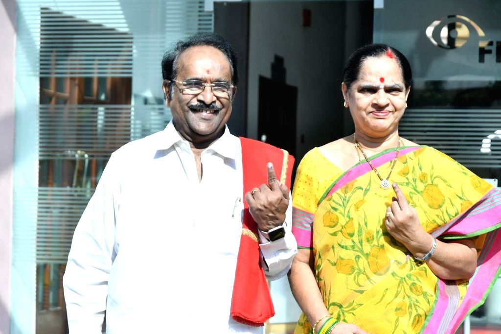 Telugu writer Paruchuri Gopala Krishna shows his inked finger after casting vote for Lok Sabha election, in Hyderabad, on April 11, 2019.