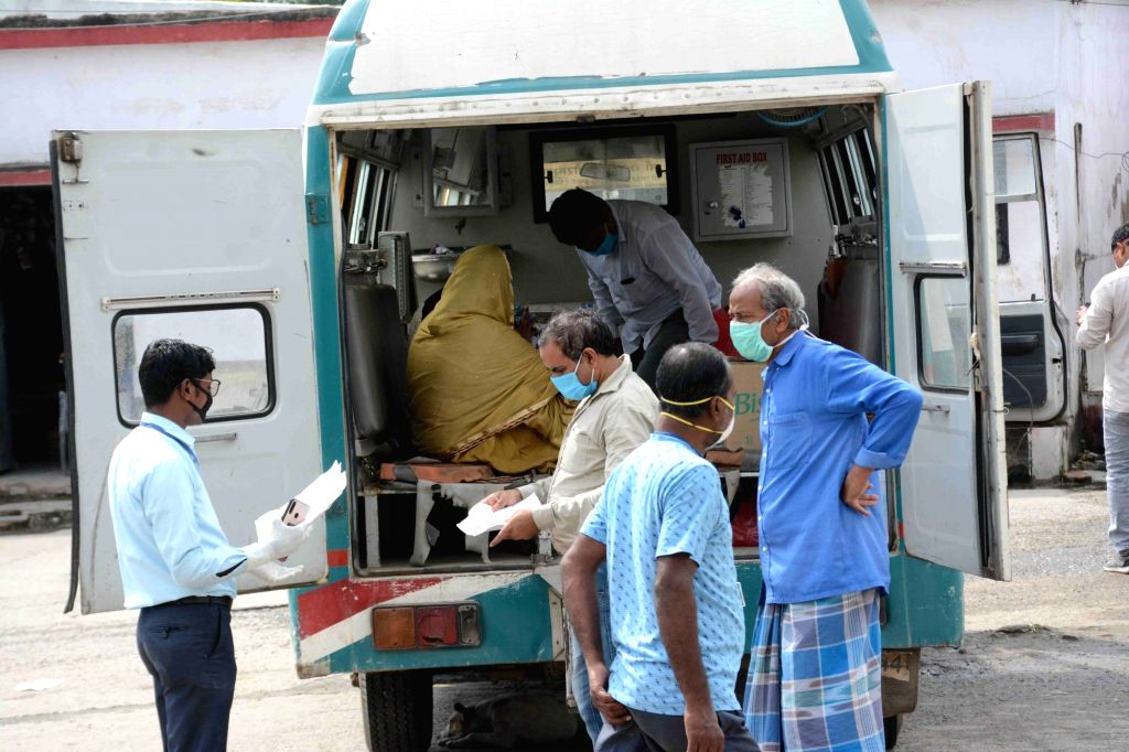 Ten COVID-19 patients return back home after being discharged post recovery from the Nalanda Medical College and Hospital in Patna during the extended nationwide lockdown imposed to mitigate ...
