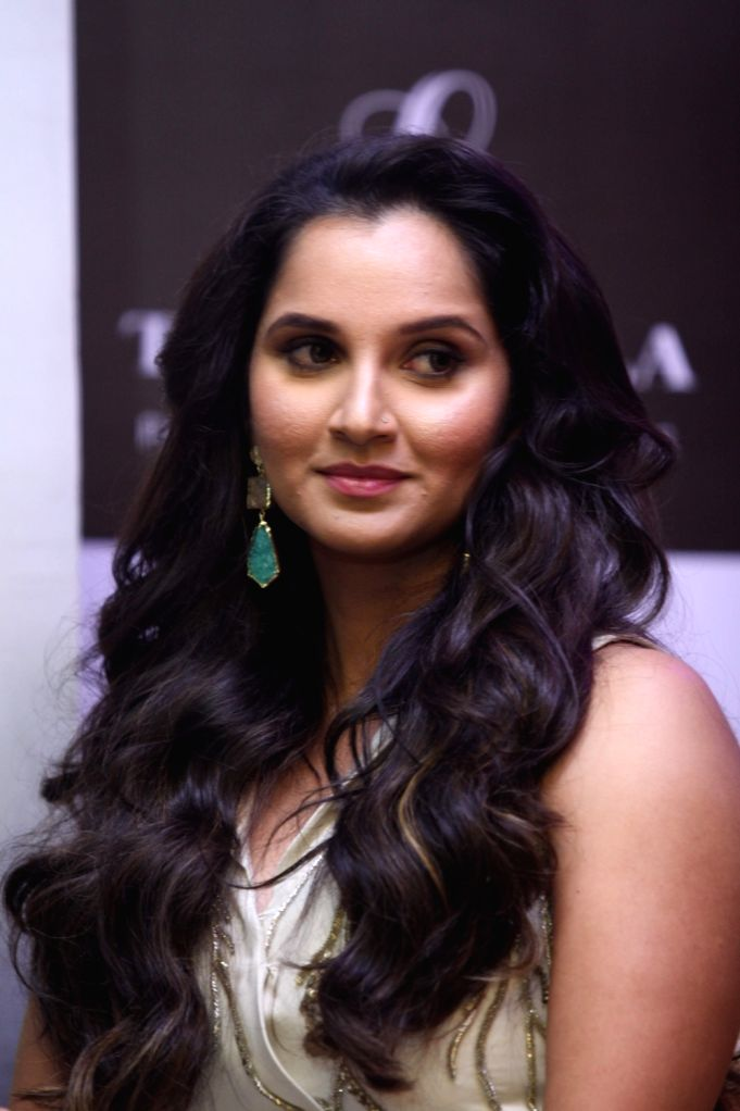 """Tennis player Sania Mirza during the launch of her autobiography """"Ace Against Odds"""" in Mumbai on July 17, 2016. - Sania Mirza"""